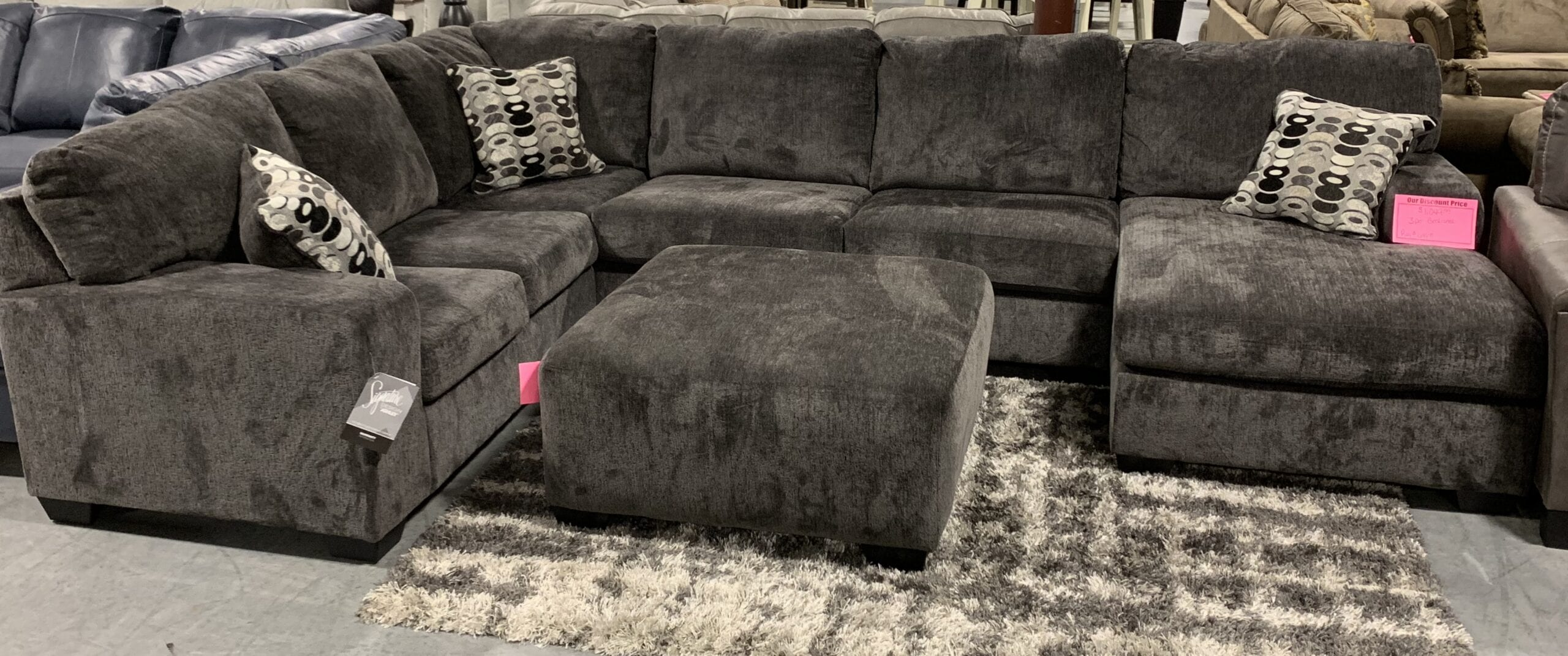 a sectional with ottoman by Ashley