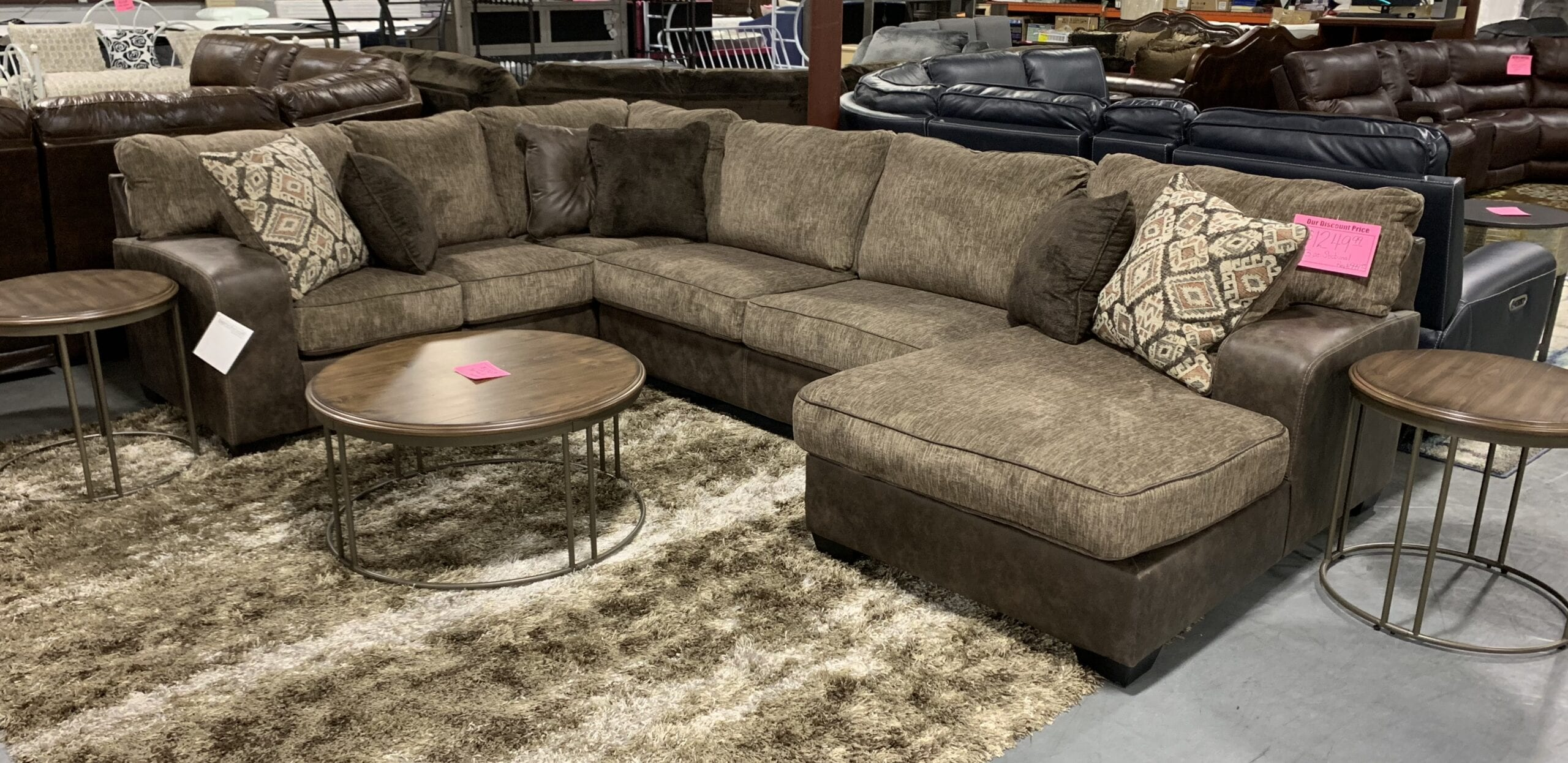 a brown sectional by Ashley